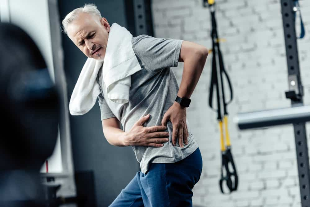 Man exercising has back pain