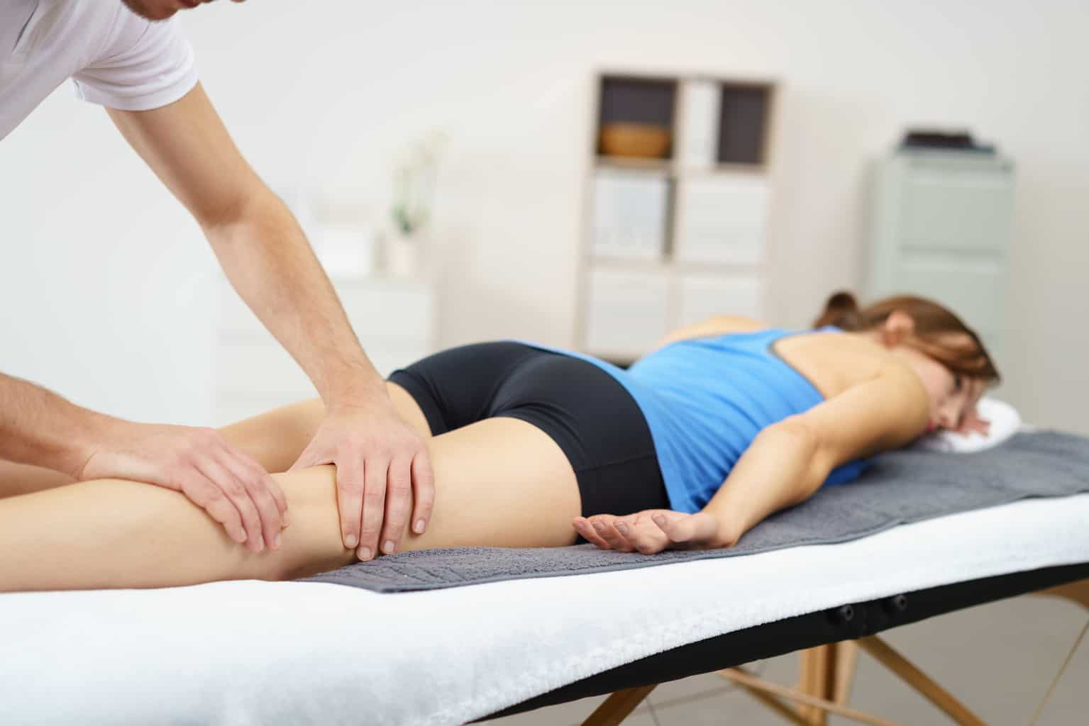 three secrets to treating a pulled hamstring include hands on care, rest, and light exercise